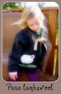 comfy felted wool cardi with needle felted sheep and decorative collar..featured in Altered Couture Magazine..for sale in my Fox Den Shop