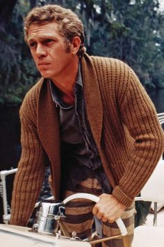 Steve McQueen doin' it right with a shawl collar cardigan, button down, and striped pants.