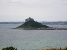 "St Michael's Mount, meaning ""hoar rock in woodland"", also known colloquially by locals as simply the Mount is a small tidal island in Mount's Bay, Cornwall, United Kingdom."