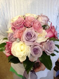 Bridal Bouquet of White Roses, Lavender Roses, Purple Roses and Pink Roses with added Broaches.