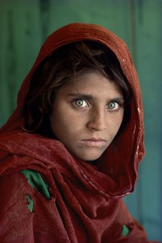 """Afghan woman, Pakistan, 1985, by Steve McCurry.   This iconic photograph of a young Afghan refugee in Pakistan named Sharbat Gula was published on the cover of National Geographic in June 1985. In 2002, the photographer Steve McCurry went to Pakistan to find the woman. She said that she still does not feel safe. """"Have you ever felt you safe? """"He was asked. """"No,"""" she replied!"""