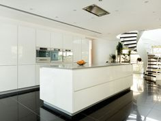 white gloss kitchen, grey worktop