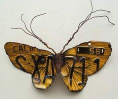 These giant 'scrap metal' moths just blow my breath away! They are by Kari von Wening, who uses layers of inks, acrylics and colored pencil to give her creatures such luminous colours. http://ullam.typepad.com/ullabenulla/2006/04/scrap_metal_mot.html