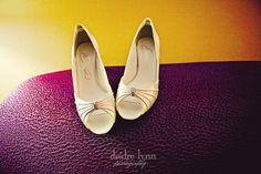 Timelessly elegant creamy gold hued peep-toe heels.
