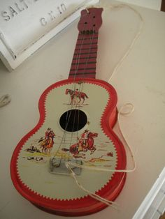 1960s Toy Cowboy Guitar ~ Back to the Old West Mine is decorating the laundry room now!