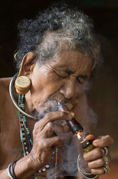 Rehahn Photography (on FB) An elder lady from Xtiêng ethnic group (South of Vietnam) This pipe will be displayed in my new Gallery  Museum in Hoi An