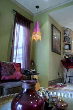 Custom made sheer drapery panels and custom made decorative pillows in Plum Purple with  complimentary Sage green walls from Jane Hall Deign interior design project.