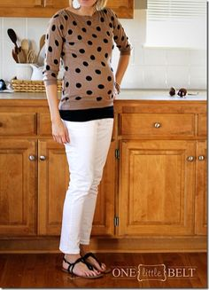 Sweater with longer layer beneath. Smart idea to wear those regular clothes that may be a little too short.
