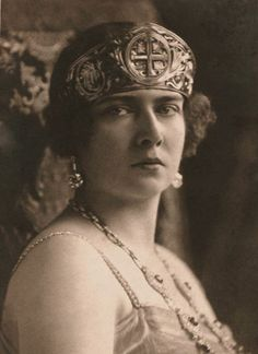 Maria of Romania, Queen consort of King Alexander I, wearing the Golden Cross Tiara, Yugoslavia (1910; gold). Originally belonging to Queen Marie of Romania, she gave it to her daughter Princess Maria when she married King Alexander I of Yugoslavia.