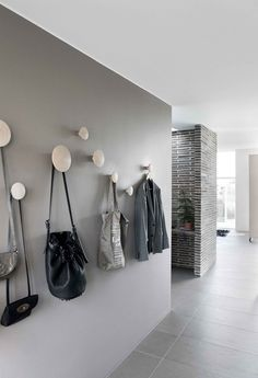 Grey walls and Muuto dots in the hallway. Read More by muuto. Grey walls and Muuto dots in the hallway. Decoration Hall, Entryway Decor, Entryway Storage, Wall Storage, Hallway Inspiration, Interior Inspiration, Interior And Exterior, Interior Design, Entry Hallway