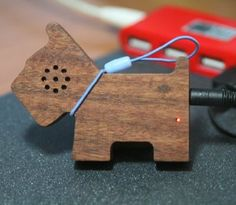 New Wood Speaker Shaped Like a Dog From Pyramid Distribution.  lol.  i love how it plugs into the dogs butt.
