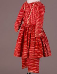 65e8e3b5ac3cfe Little girl s printed red calico dress with white braid trim and matching  pantaloons