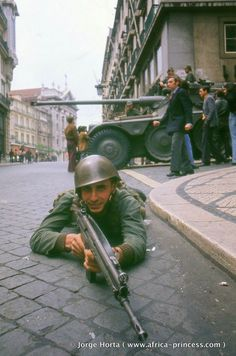 "1974 Carnation Revolution - Portuguese Army soldiers and armored cars of the left-wing revolutionary Armed Forces Movement (Movimento das Forças Armadas) mobilize on the streets of Lisbon in a coup d'etat against the Fascist ""Estado Novo"" regime."