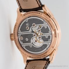 """The Grönefeld Parallax Tourbillon features a """"flying"""" tourbillon with a large central seconds hand, stop seconds, a power reserve- and winding-setting mechanism indicator. For more information, please visit: http://www.gronefeld.com/en/collection-parallax-c3-p7.php"""