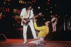 Singer Freddie Mercury - and guitarist Brian May of British rock band Queen in concert at Wembley Stadium, July (Photo by Dave Hogan/Getty Images) Queen Freddie Mercury, Queen Mercury, John Deacon, Radiohead, Def Leppard, Brian May Queen, Metallica, Beatles, Queen Albums