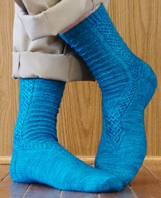 Neldoreth sock celtic ish cable knitting pattern - these socks have the nerdiest naming story I have ever read. Well done.