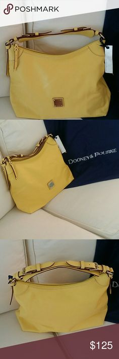 Beautiful NWT Dooney & Bourke Slouch Bag NWT Beautiful Dooney & Bourke Slouch Bag in Pale Yellow leather. Interior is pink and white with a side pocket plus an additional zippered pocket and a leather steap with a gold clip for your keys. Retails for $250. Ships with Dust bag and authentication card. This is the perfect bag for the spring and summer! Dooney & Bourke Bags Shoulder Bags
