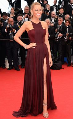 Blake Lively looks fierce in this ox-blood Gucci ensemble with a thigh-high slit.