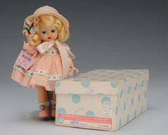 Nancy Ann Storybook Hard Plastic Muffie Doll- doll style changes from the 1940 style of painted eyes and comp bodies.