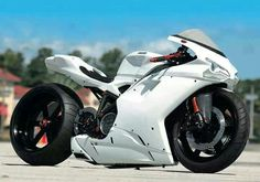 not a fan of white ones but this custom sport bike is an absolute beaut, just look at that shape and style of the exterior.