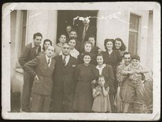 In Albania during the Holocaust, many Muslim communities chose to save Jews.  People saved Jews by providing hiding places and misdirecting the Nazis. Photo: Refik Veseli. October 29, 1944, Jewish refugees protected by Albanians pose for a photo following the liberation of the country.