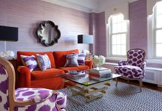 thinking of switching up the colors in my family room.  I too have an orange leather couch, this is too much for me, but one or two of those purple color pillows along with some navy may be my new color choice.