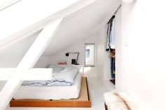 more creative uses of the attic space. low bed high closet.