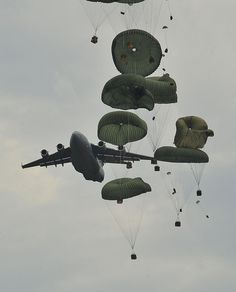 During Joint Operations Access Exercise, Globemaster IIIs drop heavy equipment supplies for an airlift mission on Fort Bragg, N. Military Jets, Military Aircraft, C 17 Globemaster Iii, Us Army Rangers, Fort Bragg, Women In History, Ancient History, Us Air Force, Aviation Art