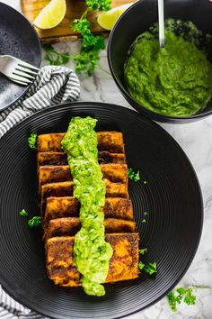 This delicious Baked Tofu Steaks With Chimichurri Sauce is so flavorful. Tofu marinated and baked then topped with a mouthwatering avocado chimichurri sauce.