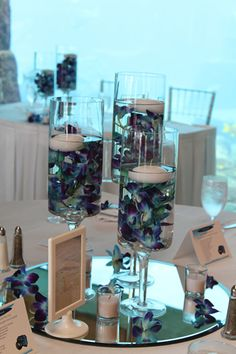 blue orchid/floating candle centerpiece. Purple and not for the wedding but for one of the showers :)