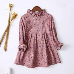* Zipper closure back<br /> * Material: 100% Cotton<br /> * Machine wash, tumble dry<br /> * Imported<br /> <br /> Pretty leaves pattern and stand collar add charm to this long-sleeve dress that is wonderful for your autumn days.