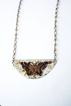 Sweetsagejewelry @ Etsy........ Love the antique feel to this repurposed tin necklace.