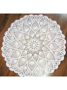 Graceful pineapples change size and flow into each other as the doily blooms into its full size. Doily measures in diameter and uses size 10 crochet cotton. Also includes instructions for smaller doily designs by simply fastening off after s. Crochet Tablecloth Pattern, Free Crochet Doily Patterns, Crochet Baby Dress Pattern, Annie's Crochet, Crochet Mandala, Crochet Home, Thread Crochet, Filet Crochet, Crochet Gifts