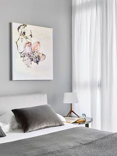 B&B Italia Charles bed  and F oscarini Lumiere XXS table lamp  with bronze base and white shade.