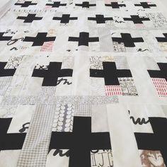Black plusses, low-volume background quilt