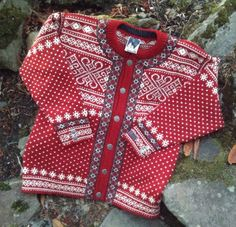 Great looking, vintage, excellent condition DALE of NORWAY sweater. Red and white snowflake pattern with six pewter buttons. 100% wool.    20 across