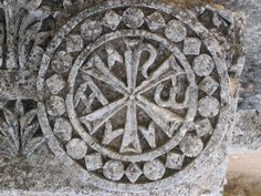 The Christian Chi Rho symbol, the origin of which is the Sumerian 6 point star, the symbol of several of their gods. Church of Saint Simon of Stylites, Aleppo, Syria.