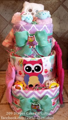 Who Who doesn't love a colorful Owl Diaper Cake by 209 Diaper Cakes & Gifts - facebook.com/209diapercakes