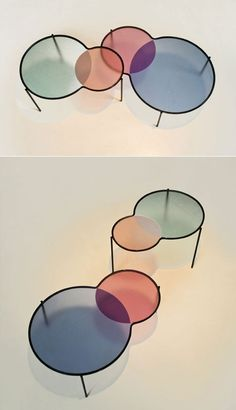 Hues - Inspired by the overlay of colors in venn diagrams, this set of nesting tables is composed of waterjet-cut low iron glass tops that are sandblasted and coloured. Legs and support frame in painted steel.