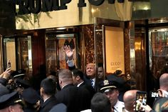 Image: Republican presidential nominee Donald Trump waves to supporters outside the front door of Trump Tower where he lives in the Manhattan borough of New York