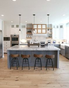 Modern farmhouse kitchen. I love the blue with those darker wood stools. :)