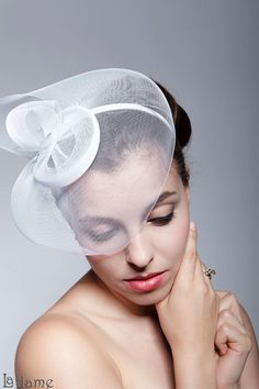 White shell - white crinoline decorated with two crystals fixed on headband