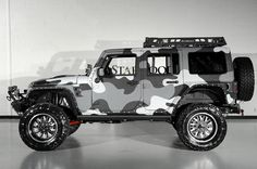 2014 Jeep Wrangler Unlimited Rubicon with Kevlar Finish in Camo Pattern: Custom Side Step