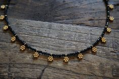 Dangling vermeil gold flower charms set with genuine black spinel gemstones. Charms are of pure silver or with gold-plating. Length approx adjustable to Elegant Indian Sarees Click Visit link above for more details Gold Jewellery Design, Bead Jewellery, Beaded Jewelry, Beaded Necklace, Jewellery Making, Silver Jewelry, Quartz Jewelry, Onyx Necklace, Gold Necklaces