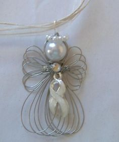 Lung Cancer Awareness Pearl Ribbon Angel Necklace Silvertone Wire Angel is 2 inches and strung on a 16 White Ribbon Necklace Cord that has a extension chain It has a Large Ring attached to the pendant so you may remove and place on an. Wire Crafts, Bead Crafts, Jewelry Crafts, Wire Ornaments, Angel Ornaments, Breast Cancer Crafts, Lung Cancer Awareness, Angel Crafts, Awareness Ribbons