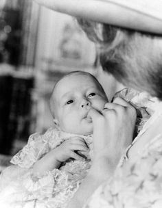 britishmonarchy:  Prince William at his christening sucking on his mother's finger, 1982
