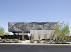 Tresarca House / assemblageSTUDIO & Designlush - A single-family house outside Las Vegas, Nevada, designed by assemblageSTUDIO. A mesh-covered second story sits above the solid walls of the house's first floor and cantilevers beyond it to create a shaded patio appropriate to the desert climate. Tresarca is a showcase of organic, nevada haven Tresarca is a sophisticated, modern structure with formal drought-resistant gardens desert oasis modern design that fuses function and form...