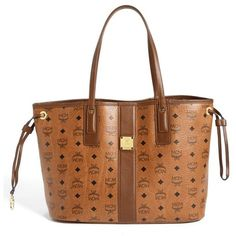 Women's MCM 'Medium Liz - Visetos' Reversible Shopper ($560) ❤ liked on Polyvore featuring bags, handbags, cognac, reversible handbag, wristlet handbags, mcm bags, structured purse and shopping bag