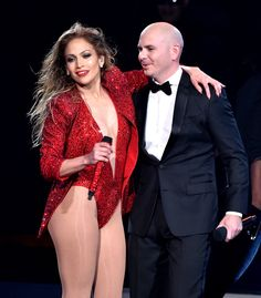 Jennifer Lopez Photos - Recording artist Jennifer Lopez (L) and host Pitbull perform onstage at the 2014 American Music Awards at Nokia Theatre L. Live on November 2014 in Los Angeles, California. - American Music Awards Show Jenifer Lopes, American Music Awards 2014, Latin American Music, Sexy Outfits, Looks Adidas, J Lopez, Jennifer Lopez Photos, In Pantyhose, Female Singers