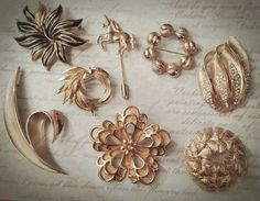 Vintage 8 pcs Brooches Lot Signed Destash Crown Trifari Coro Craft D'orlean Sarah Coventry Gold Tone Rhinestones Enamel Flowers Figural by ArtsyMysticDesigns on Etsy Brooches, My Etsy Shop, Enamel, Crown, Coventry, Bracelets, Rhinestones, Gold, Crafts